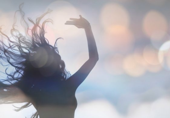 Dancing Silhouette of Female and Bokeh